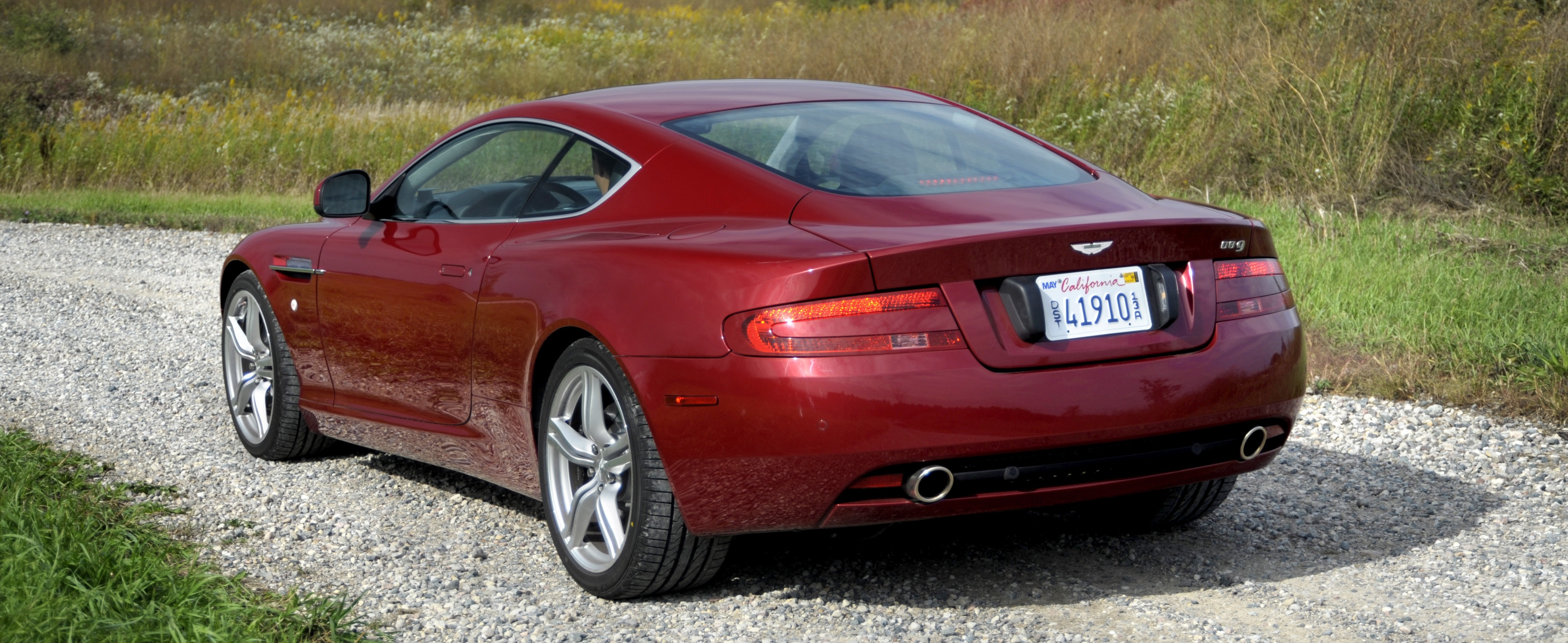 The 1 760 kg db9 coup is no flyweight sports car its ride is relatively firm but that means controlled body motions and balanced cornering